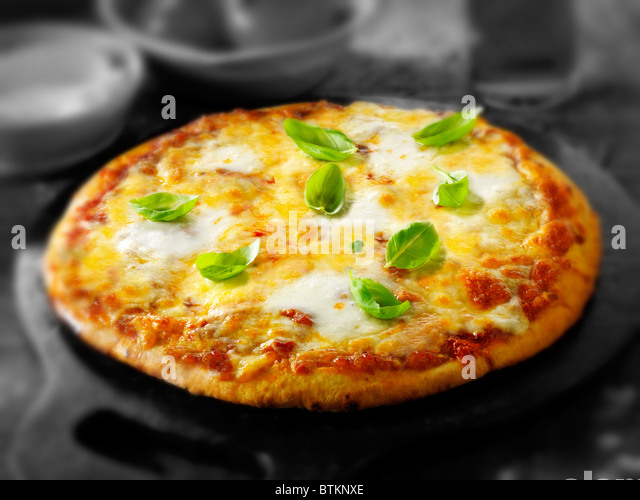Whole Cheese and Tomato thin crust pizza - Stock Image