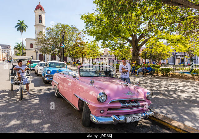 Classic 1950's Plymouth taxi, locally known as almendrones in the town of Cienfuegos, Cuba, West Indies, Caribbean - Stock-Bilder