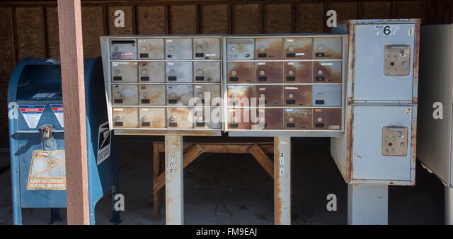 Old Rural Mobile Locked Mail Boxes and U.S. Postage Box, Idaho, USA - Stock Image