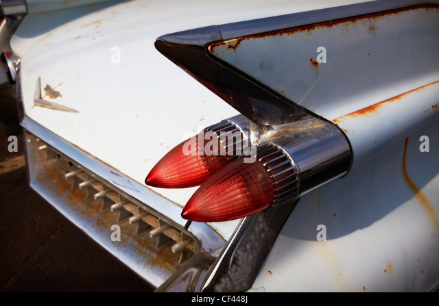 The tail fin and taillights of a 1959 Cadillac Deville. - Stock Image