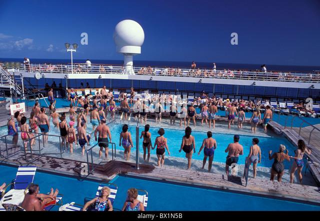 aquatic gymnastics bathing cruise cruise ship deck fitness holidays no model release passengers pool Royal - Stock Image