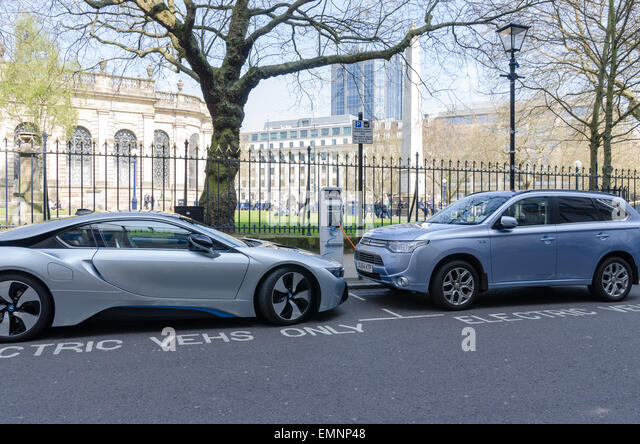 Electric cars charging in Birmingham City Centre - Stock Image