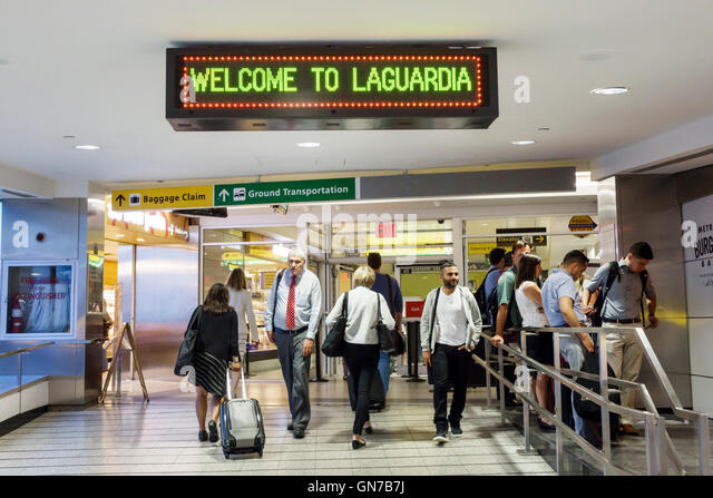 New York NY New York City Queens LaGuardia Airport LGA domestic airport terminal sign baggage claim ground transportation - Stock Image