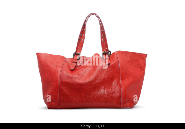 A Gérard Darel's handbag, 'Simple Bag Bahia' model, photographed in the studio on a white background - Stock Image