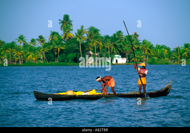 India Kerala indian on a small boat in backwaters - Stock Image