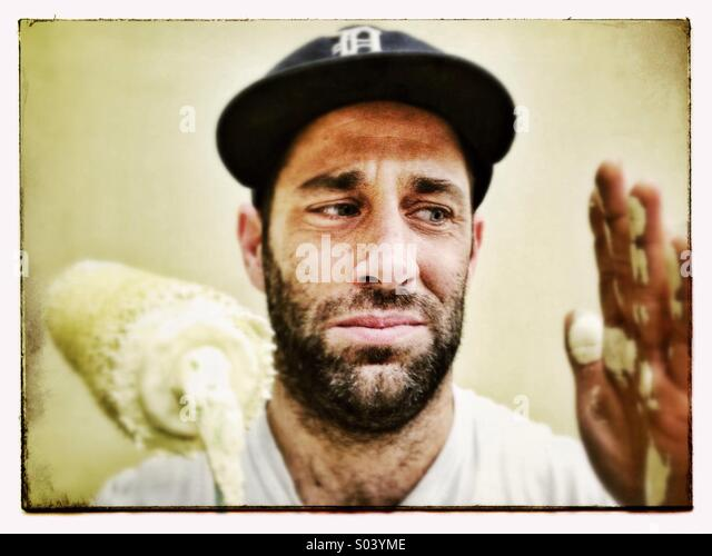 Guy painting - Stock Image