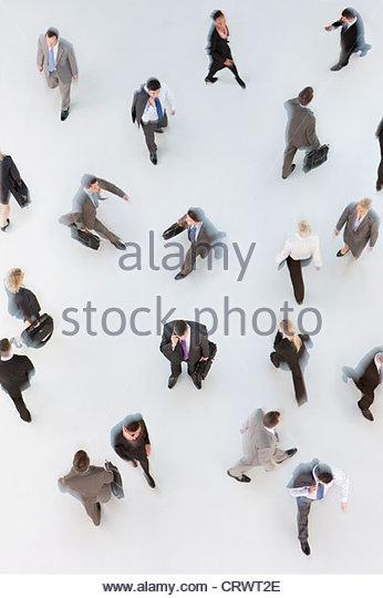 Business people walking on white background - Stock Image