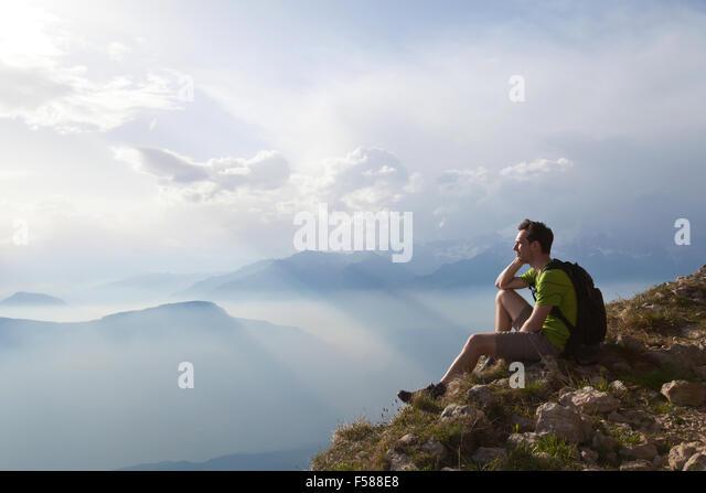 traveler enjoying panoramic view during hike, beautiful background with mountain landscape - Stock Image