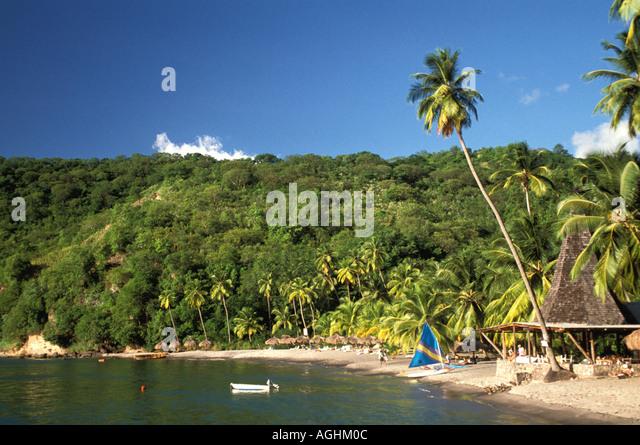 Caribbean St Lucia beach black sand beach Anse Chastanet Resort sailboats scenic - Stock Image