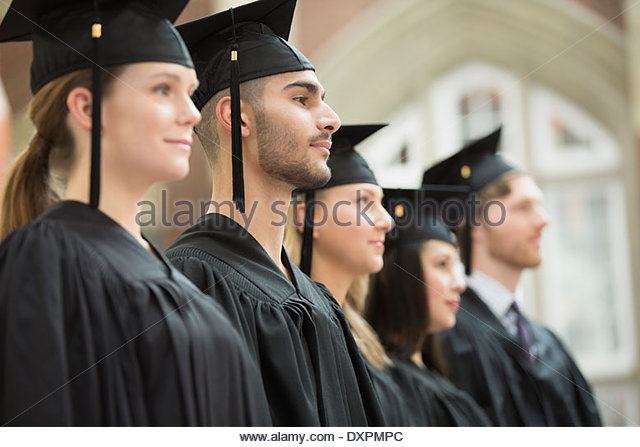 College graduates standing in a row - Stock Image