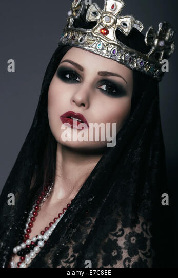 Face of Witch in Silver Crown with Jewels - Stock Image