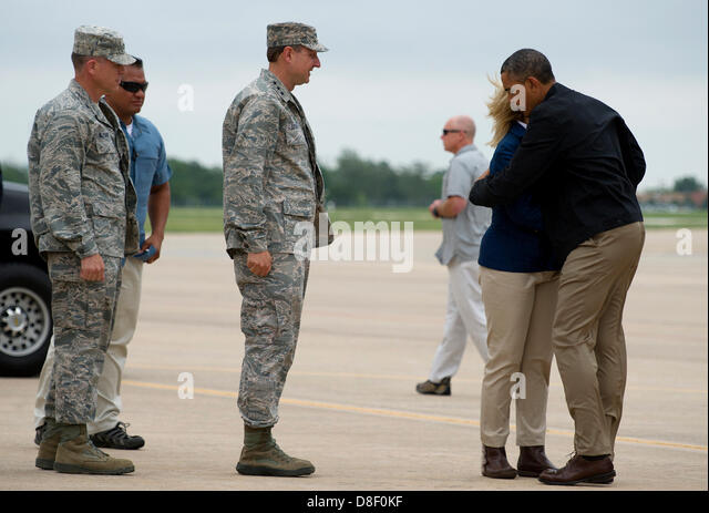 US President Barack Obama hugs Oklahoma Governor Mary Fallin at Tinker Air Force Base on his way to tour areas damaged - Stock Image
