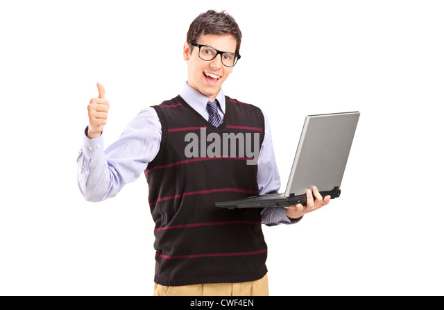Happy young man with laptop showing thumb up isolated on white background - Stock Image