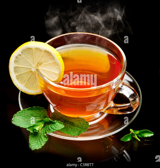 Cup tea with mint and lemon isolated on a black background. - Stock-Bilder