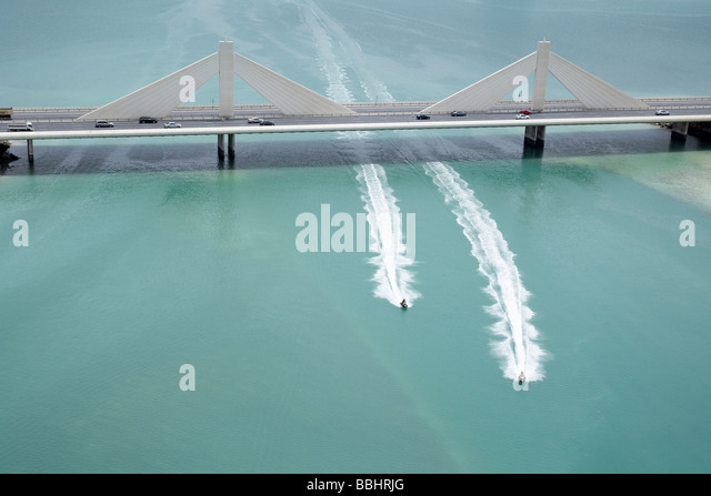 2 Jet skis passing under the causeway in Bahrain - Stock Image