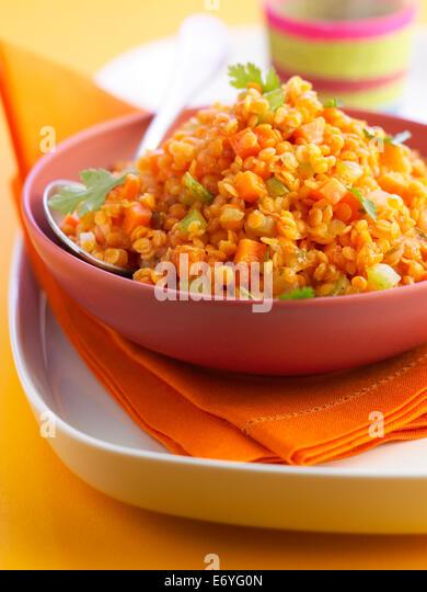 Orange lentils with carrots - Stock Image