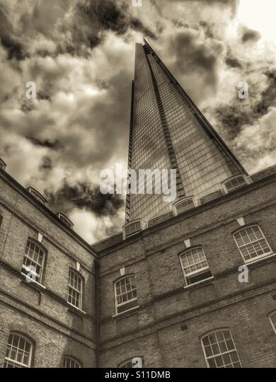 Contrasting architecture. Victorian buildings between the ultramodern skyscraper, the shard. London, U.K. - Stock Image