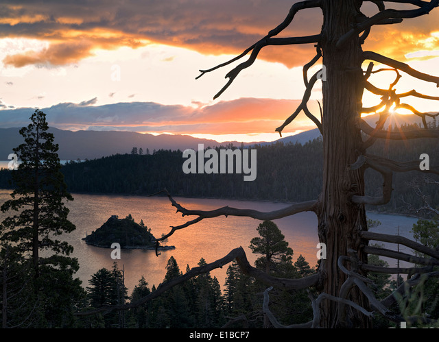 Sunrise over Emerald Bay with dead tree and Fannette Island, Lake Tahoe, California. - Stock Image