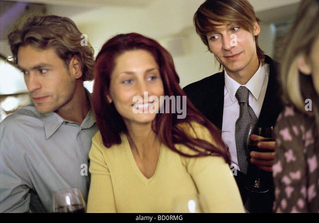 Young man watching woman at bar - Stock-Bilder