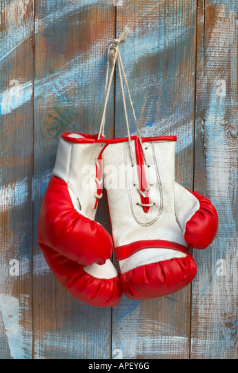 A Pair of Boxing Gloves Hanging from a Nail - Stock Image