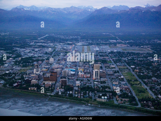 aerial above Anchorage, Alaska from the Cook Inlet at dusk during the summer time midnight sun - Stock Image