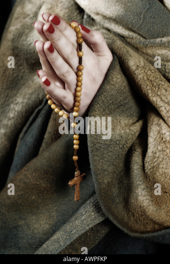 Praying hands in habit with rosary - Stock-Bilder