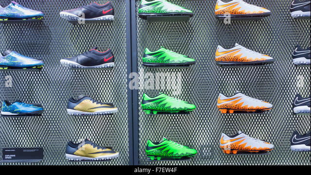 Nike football boots display in JD sports store in UK - Stock-Bilder