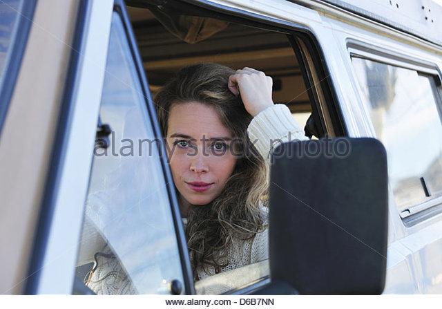 Woman driving van - Stock Image