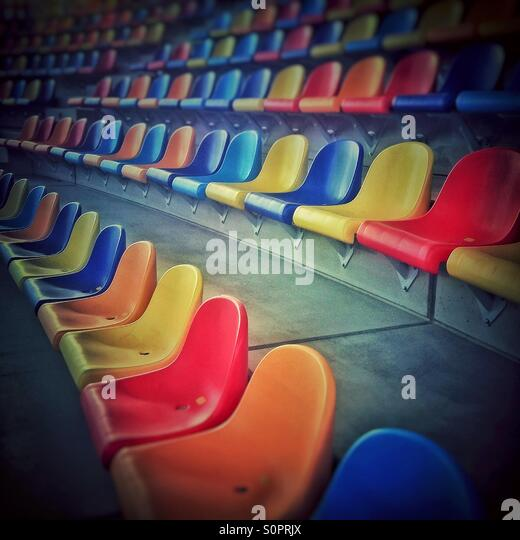 Colorful seats at Athletics Stadium in Sabadell, Catalonia - Stock Image