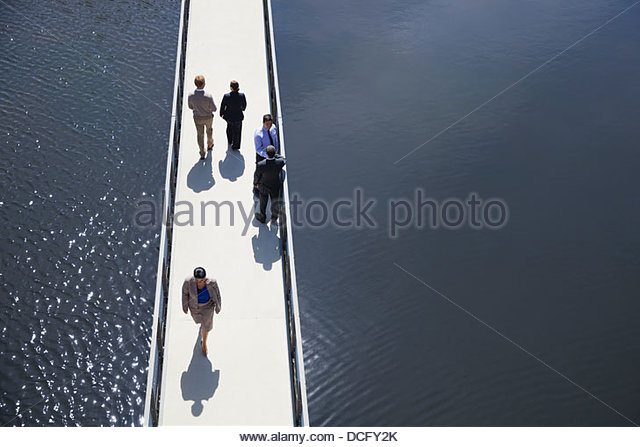 High angle view of business people on bridge - Stock Image
