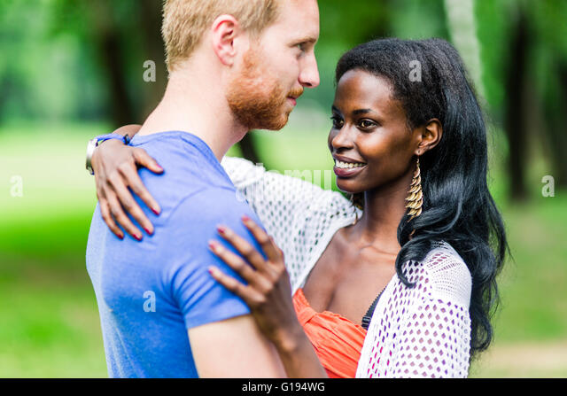 Couple in love hugging peacefully outdoors and being truly happy. Feeling of security and serenity - Stock-Bilder