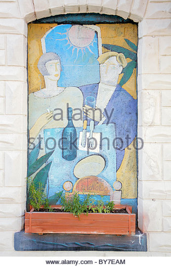 Baltimore Maryland Little Italy ethnic neighborhood community restaurant exterior mural dining flower box - Stock Image