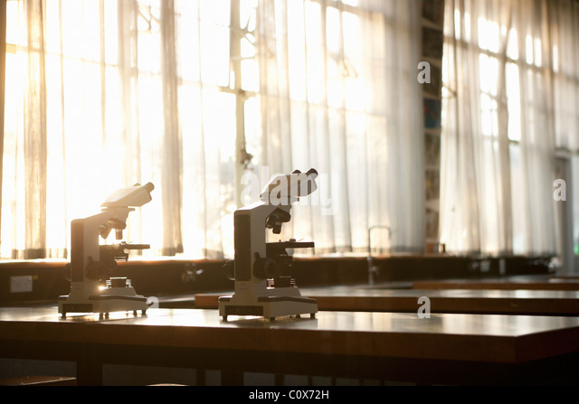 Two micrpscopes on bench - Stock Image