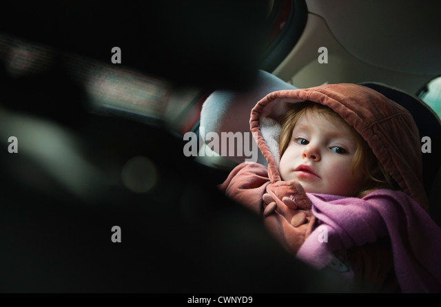 Little girl in car seat, portrait - Stock Image