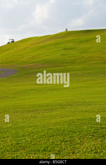 Bermuda golf courses st george golf course uphill hilly green golfer at top height bermudian sports - Stock Image