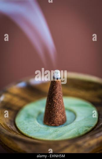 Burning incense cone. - Stock Image