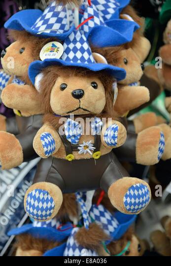 Teddy bear in traditional Bavarian dress on a stall, Oktoberfest, Munich, Upper Bavaria, Bavaria, Germany - Stock-Bilder