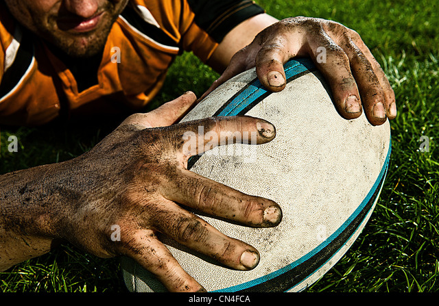 Rugby player scoring on pitch - Stock Image