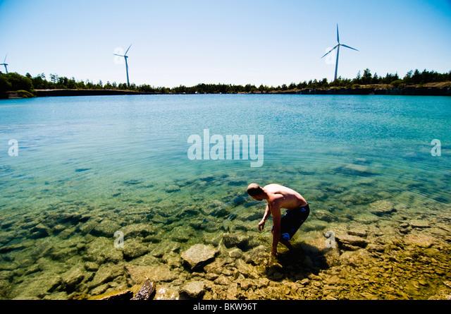 Man walking in the water - Stock Image