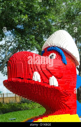 Legoland Florida tourist attraction red Lego dinosaur - Stock Image
