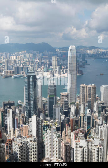 Daytime skyline of Hong Kong and Victoria Harbour from The Peak on a clear day - Stock Image