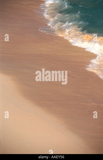 Bermuda Pink Sand Beach foam waves green water beaches landmark symbol surf - Stock Image