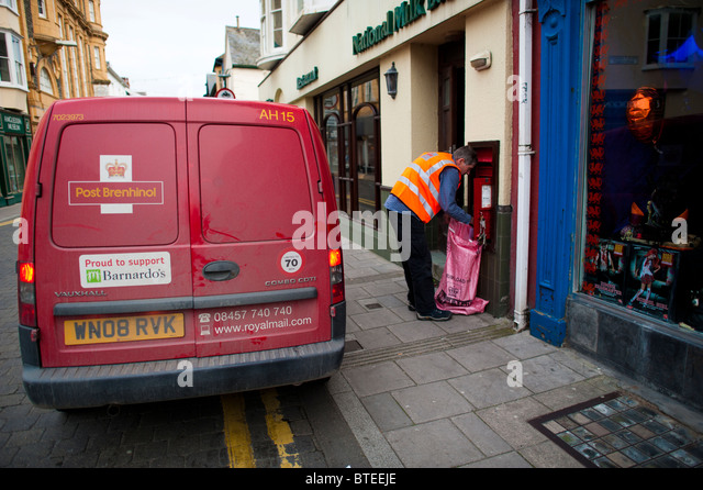 Royal Mail postman collecting post, Aberystwyth Wales UK - Stock Image
