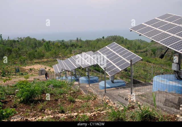 Solar panels for water supply near Parangtritis, Central Java, Indonesia, Southeast Asia - Stock Image