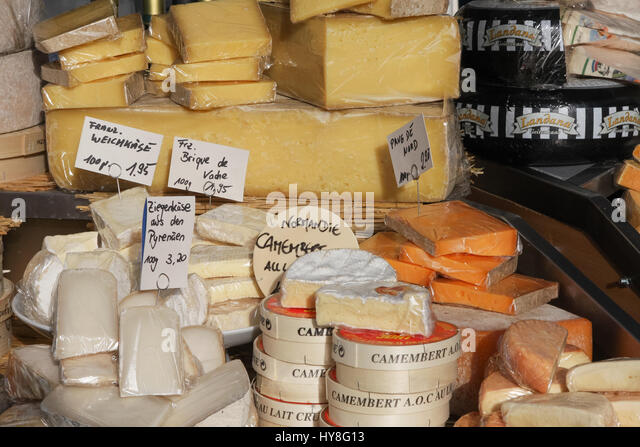 Cheese for sale at market stall in Viktualienmarkt., Munich, Germany - Stock Image