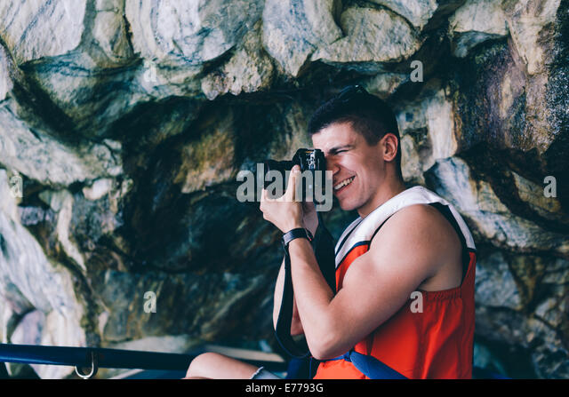 Man photographing on camera - Stock Image