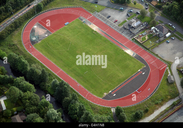 Aerial view of a red athletics running track and field. This one at ...