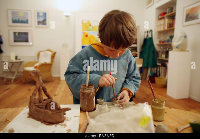 Boy making pottery - Stock-Bilder