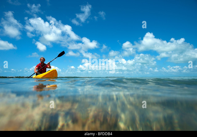 A man kayaks in Florida. - Stock Image