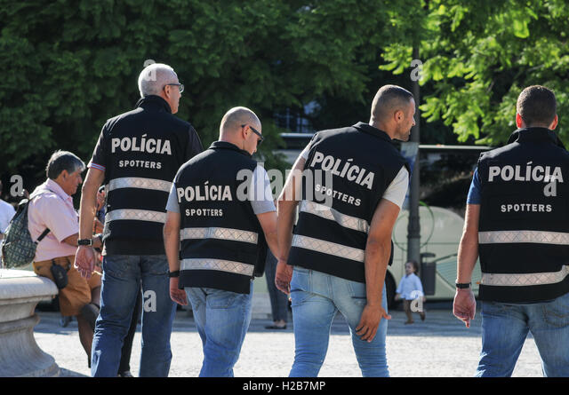 Portuguese Police looking out for football supporters causing trouble in Lisbon - Stock Image